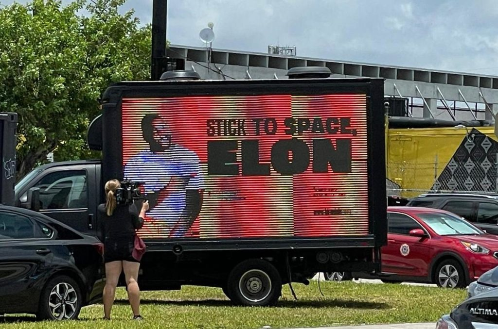 Stick to space Elon sign at Bitcoin 2021